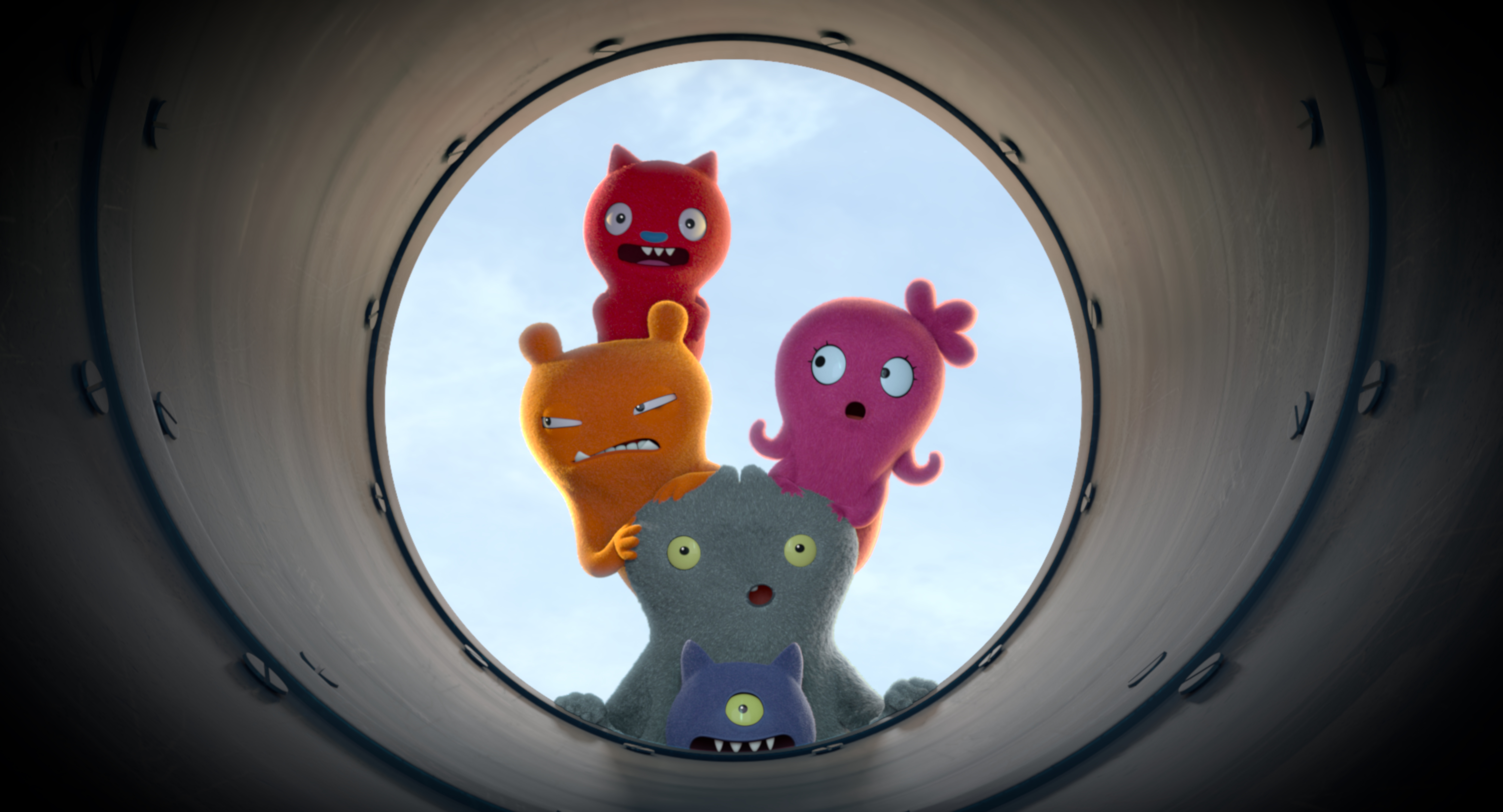 Five 'UglyDolls' look down a tunnel.