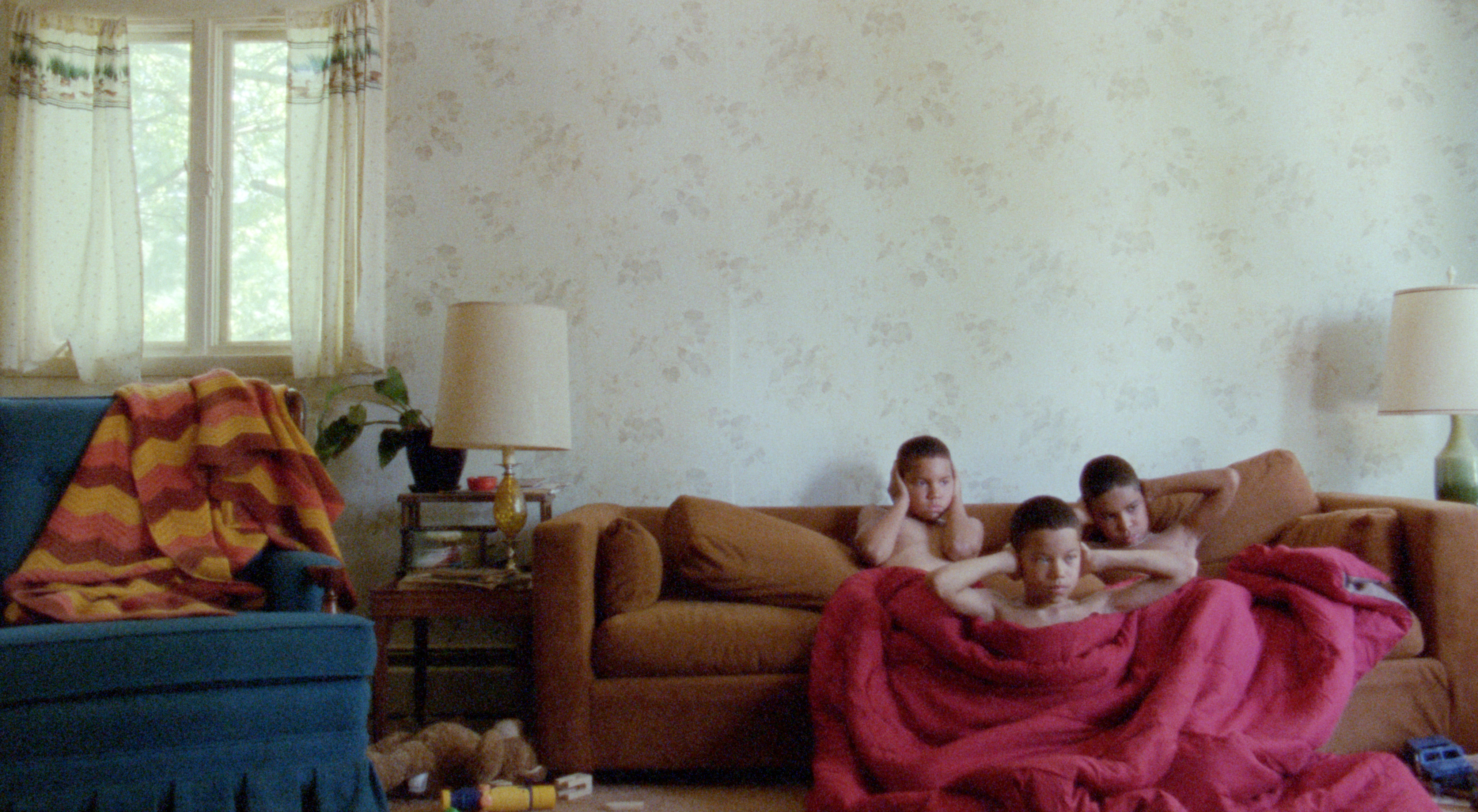 A pack-like trio of brothers face a troubled childhood in We the Animals