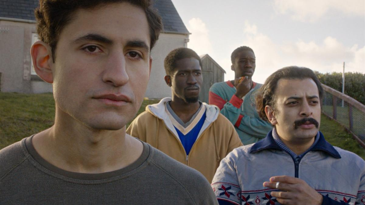 Four men stand, close up shots of their faces, on a remote Scottish island. They are refugees.