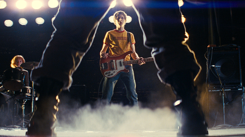 Michael Cera, holding a bass guitar, in Scott Pilgrim vs the World